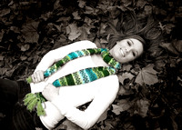 Color Black and White laying in leaves
